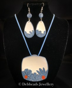 White Square Pendant with blue stripy flowers - showing with matching earrings