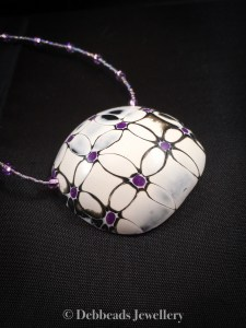 Black, white and purple mokume gane flower necklace - side view