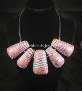 5 Hollow pink toned missioni beads