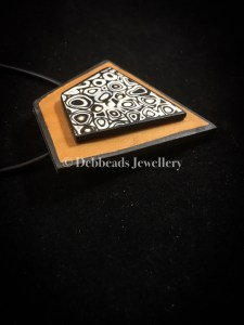 Gold framed mokume gane pendant - side view